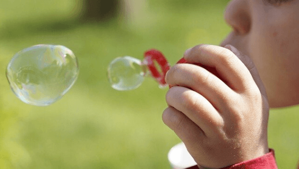 breath out as if blowing bubbles